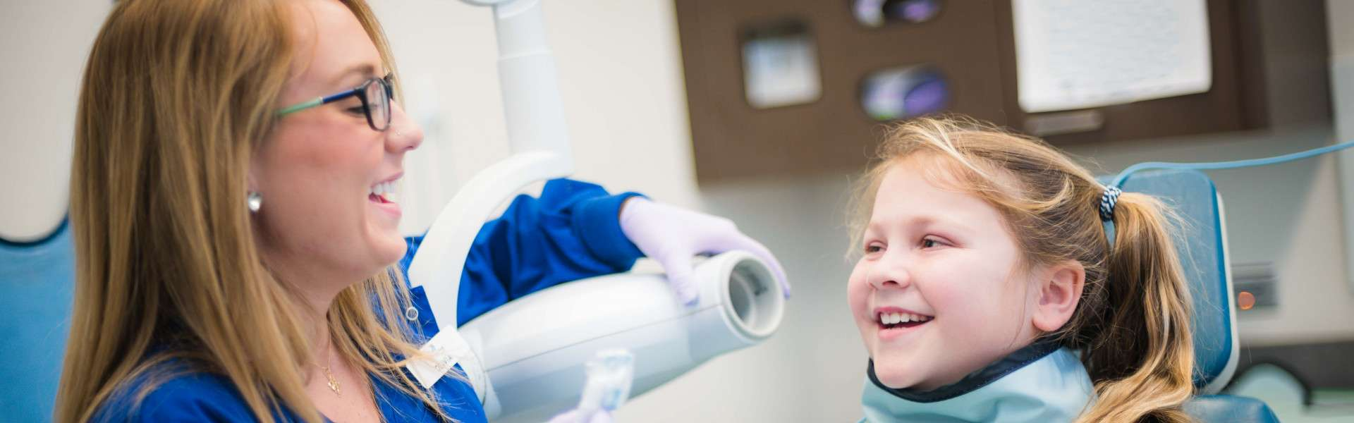 Dental Assistant taking X-rays of young patient